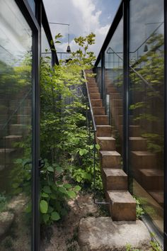 Seoul office block featuring a secluded garden. Subtle but memorable office entry. Pinned to Garden Design - Paving & Stairs by Darin Bradbury.