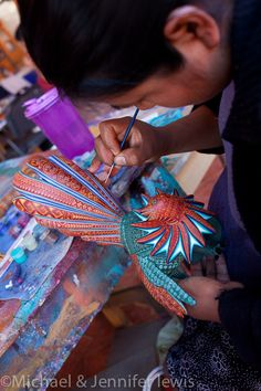 Making a rooster alebrije, workshop of Jacobo and Maria Angeles in San Martin Tilcajete, Oaxaca