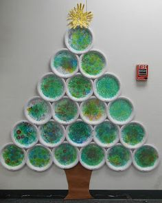 Every child paints a paper plate. Put them together and you have a Christmas tree!
