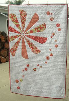 The Pink Quilt by Handmade Mommy. I really like this design, but I can see a poem being embroidered in the white space.
