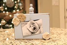 Will be making this for AD, putting CTR on instead of the flowers. Finials are tricky to find around here, but I think drawer knobs would work as well. That picture is so precious!
