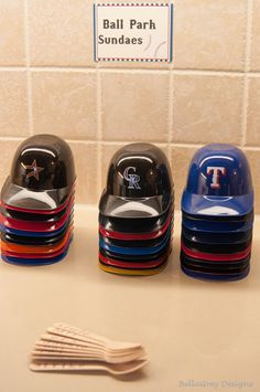 Baseball party ~ Mini ice cream sundae baseball helmets to round out the party elements along with mini wooden spoons!