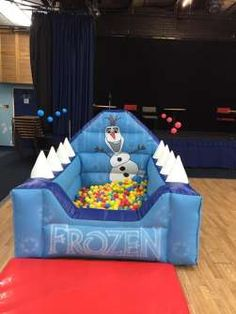 This frozen themed ball pool is very popular at younger kids parties . The front panels feature images of frozen in writing , while Olaf is featured on the back wall. This ball pool comes with 2000 plastic play balls and also features an air jugglers game .