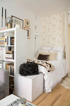 How to Make a Bedroom in a Studio Apartment | You can get creative and carve out a bedroom for yourself even if your apartment didn't come with one. It can make it feel like you're living in a dorm room versus an actual adult home. But, with smart decor elements and design tricks, you can make your bed feel like its own area, improving the way your studio looks from any angle.