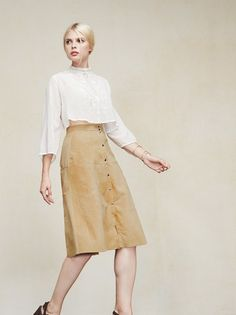 This is part of the Reformation x Jeanne Damas collection. The Bonilla Skirt - your friends will think you spent hours thrifting for it when really all you had to do was click. We like to make things easy for you. This is a partially lined suede midi skirt with a snap button up front and paneling. High fitted waist, then it goes A-line. The fabric is a surplus suede that we hand-pick and show a lot of love to - because it shouldn't have to end up in the landfill. Made from surplus suede.