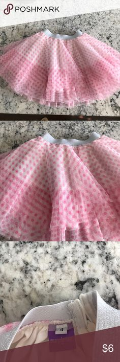 Girls tulle skirt in size 4 Girls pink tulle skirt in size 4. Never worn but no tags attached. purple tag Bottoms Skirts