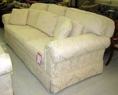 95 X 45 X 36 Cream Colored Upholstered Sofa. Raised Floral Design. Has Down  Stuffed Pillows. Loose Seats And Double Pillow Back. Rolled Pillowtop Arms.