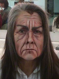 This would be a good old age make up for an audience at a distance due to the heavy lines and shadows.