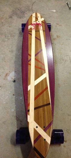 The orchid board for Agape International. Bamboo with Wenge, Paduak, Purple Heart and Maple inlay.