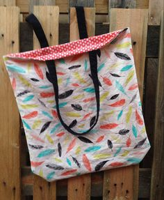 Aqua, coral, lime and black feather tote bag with reversible coral polka dot inside. Too cute!