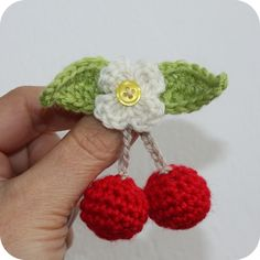 Lovely brooch but I would embroider the centre rather than use a button Crochet Brooch, Crochet Amigurumi, Crochet Motif, Crochet Designs, Crochet Earrings, Crochet Patterns, Crochet Fruit, Crochet Food, Love Crochet