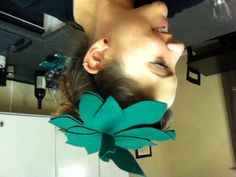 Fruit costume hair piece!  $.58  Two Felt fabric sheets On hair clip (I had already) Hot glue and glue gun  Cut a wavy round design, cut separate pieces that look like leaves, roll a piece for the stem and hot glue! Viola!