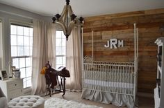 Vintage Cowboy Nursery - love the rustic wood pallet wall paired with antique pieces!
