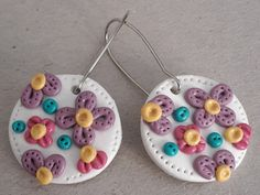 Check out this item in my Etsy shop https://www.etsy.com/listing/236855847/pretty-polymer-flower-disc-earrings