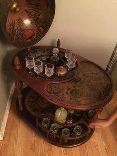 Vintage globe bar with crystal set.