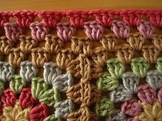 Great tutorial for a crinkle free granny square border. I am loving this colour combination.