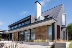 Dark-stained cedar gables contrast with knapped flint walls at this English countryside house, designed by London-based Jestico and Whiles Bungalow Extensions, Zinc Roof, Cedar Cladding, Passive House, House Roof, English Countryside, Residential Architecture, New Homes, House Design