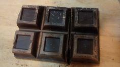 1.-¿Qué fracción es cada onza de chocolate?  2.- El chocolate está partido, ¿qué fracción representa cada cacho?