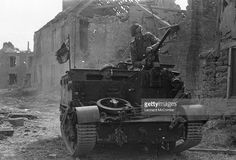 A British Bren Gun Carrier on a French street in the forward areas of the Normandy advance. Original Publication: Picture Post - 1797 - Road To Victory - pub. 1944
