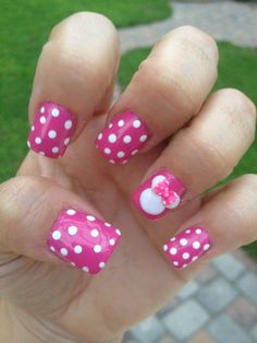 Minnie Mouse nails - Pink nails with white polka dots and on ring finger a white Mickey head with or without a pink bow