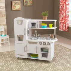 Young chefs are sure to love cooking up fun with our adorable KidKraft White Vintage Play Kitchen! This vintage play kitchen has doors that open and close, knobs that click and turn and plenty of convenient storage space. Wooden Play Kitchen, Play Kitchen Sets, Toy Kitchen, Uptown Kitchen, Ikea Kids Kitchen, Play Kitchens, Kitchen Ideas, Cocina Kidkraft, Kidkraft Vintage Kitchen