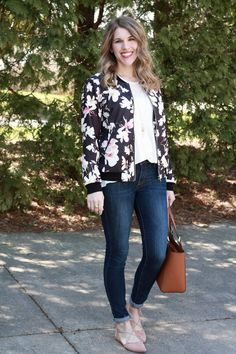Floral Bomber Jacket, jeans, and blush lace up flats