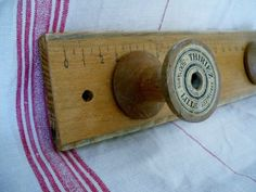 """DIY patère """"couture"""", what to do with those knobs that don't have a home.in the bathroom Wooden Spool Crafts, Wooden Spools, Wood Crafts, Ruler Crafts, Wooden Ruler, Sewing Room Decor, Sewing Rooms, Sewing Spaces, Vintage Crafts"""