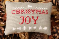 Christmas Joy Pinkeep with Snowflakes Primitive Pillow Home & Living. $17.50, via Etsy.