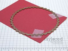 Tape the die to your paper and only run it through halfway to add a curved scalloped edge.