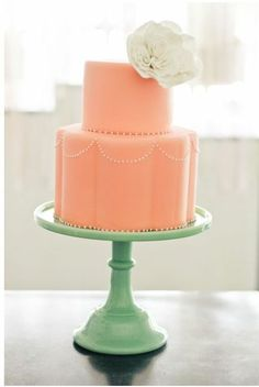 simple peach wedding cake with scalloped edges on the bottom tier.and of course we love the minty cake stand! From Sweet and Saucy Shop Coral Cake, Peach Cake, Mint Cake, Green Cake, Turquoise Cake, Pretty Cakes, Beautiful Cakes, Beautiful Flowers, Cream Wedding Colors