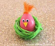 Glue feather to top of plastic egg