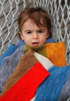 Every day at Purl at least one customer comes in looking for a really easy baby blanket pattern. It's such a basic request, and, yet, my co-workers and I have a hard time offering a basic solution. The reason is that not many knit designers bother to make patterns for simple rectangles or squares, assuming that, because it would be so easy for them to figure out, it must be easy for everyone else to figure out too! I designed this blanket using Alchemy's new yarn, Temple a super-wash,...