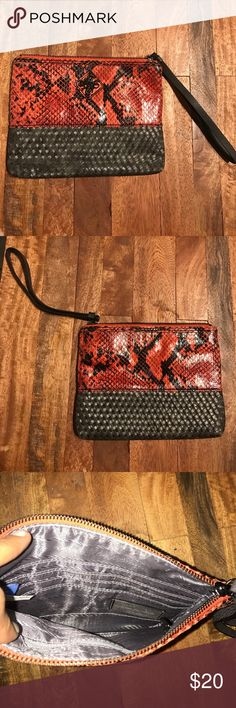 Simply Vera Vera Wang snakeskin wristlet New, only worn once! Black and blood orange snakeskin print wristlet with grey woven bottom and black accents. Simply Vera Vera Wang Bags Clutches & Wristlets