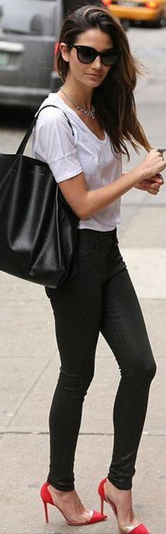 Who made Lily Aldridges black leather skinny pants, black leather handbag and clear red pumps that she wore in New York?