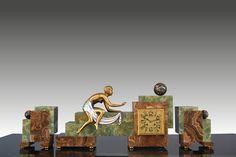 "Stunning art deco cubist clock.  Marble and onyx for structure. Figure is bronze.  Wind up ""mouvement de Paris"" works fine.  Impressive !  Circa 1930."