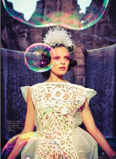 """LAKRAUSE Feather Poof headpiece paired with a Louis Vuitton laser cut dress for fashion editorial """"La-La Land"""" in PIE Magazine.   Photography: Dan Lim Styling: Sarah Jay Creative Director: Dylan K.Hanson & Dan Lim  2013"""