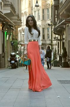 White button down shirt outfit idea rolled sleeves, tucked in with gold belt, coral maxi skirt and turquoise handbag
