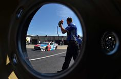 At-track photos: Saturday, Charlotte:    Saturday, May 28, 2016  -   CHARLOTTE, NC - MAY 28: Kyle Busch, driver of the No. 18 M&M's Toyota, drives through the garage area during practice for the NASCAR Sprint Cup Series Coca-Cola 600 at Charlotte Motor Speedway on May 28, 2016 in Charlotte, North Carolina.