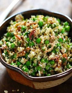 Spring Quinoa Salad tossed with peas fresh herbs feta bacon and almonds plus a homemade Honey Lemon Vinaigrette. Spring Quinoa Salad tossed with peas fresh herbs feta bacon and almonds plus a homemade Honey Lemon Vinaigrette. Salade Healthy, Plats Healthy, Healthy Salads, Healthy Eating, Healthy Potluck, Healthy Pasta Salad, Vegetarian Recipes, Cooking Recipes, Healthy Recipes