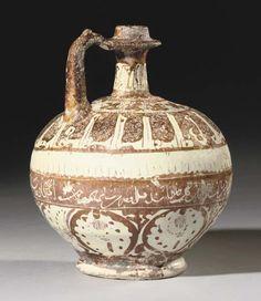 A KASHAN LUSTRE POTTERY BOTTLE   CENTRAL IRAN, CIRCA 1200