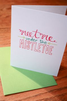 Meet me Under the Mistletoe Hand Lettering card. $2.50, via Etsy.