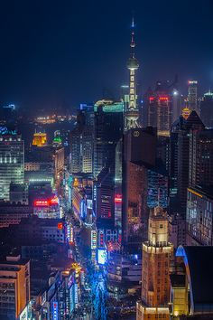 East Nanjing Road, most famous shopping strip in the world. Get a glimpse of the Oriental Pearl Tower too! Big city paradise.