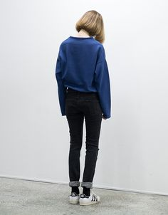 Disposable Magazine - Inspiration. Comfortable. jeans and sneakers. blue pullover sweatshirt.