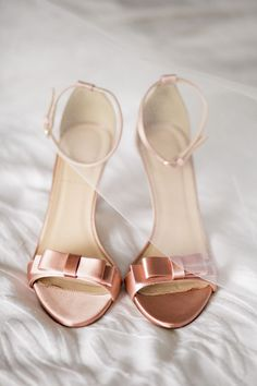 These radiant rose gold wedding shoes with delicate bow detailing are every bride's dream.