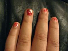 My nails one is red with a white desighn and the rest are a really light pink with a red design