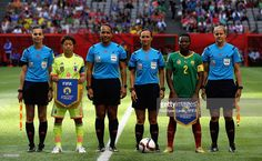 Aya Miyama of Japan and Christine Manie of Cameroon pose for a 'FIFA Handshake for Peace' photograph with the referees during the FIFA Women's World Cup 2015 Group C match between Japan and Cameroon at BC Place Stadium on June 12, 2015 in Vancouver, Canada.