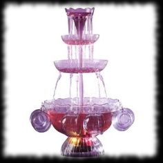 Halloween Punch Bowl Four Tier - Halloween Punch Bowl Fountain!  A seriously approachable price, plus the product actually works!  A rare combination indeed.  This will put your Halloween party guests on their heels when they see the level (pun intended) that you went to in order for them to have the best Halloween yet!  This goes great with any theme, but perfect for that Halloween Drink station for the Gothic, Vampire, Haunted House look!  HalloweenCandyForSale.com/drinks-store.html