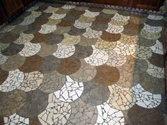 Mosaic tile floors...by The Phoenix Commotion.