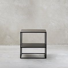 Black cube table in a timeless design. The coffee table is functional and decorative at the same time. Use the cube table with several to create dynamics.