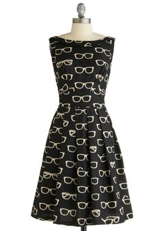 Frames and Fortune Dress, #ModCloth.  This dress is unique and would look very flattering on. It's black so it'll be a sliming perfect outfit. I would style this with my hair down wearing some thick black sunglasses and heels to compliment.